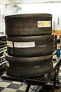 A stack of motorcycle drag racing slicks waiting mounting at Tombo Racing shop in Oklahoma City.