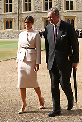 US first lady Melania Trump and Lieutenant Colonel Sir Andrew Ford walk in the Quadrangle during a ceremonial welcome at Windsor Castle, Windsor.