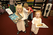 Children visiting the Edinburgh International Book Festival with a selection of books bought at the Edinburgh International Book Festival. The Book Festival was the World's largest literary event and featured writers from around the world. The 2006 event featured around 550 writers and ran from 13-28 August.