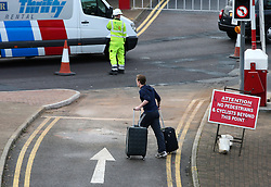© Licensed to London News Pictures. 26/11/2015. London, UK. A man forced to walk to the terminal pulling his luggage.  A group of Airport expansion activists cause traffic chaos by blocking off the inbound tunnel of Heathrow airport in London to protest against airport expansion.  Photo credit: Peter Macdiarmid/LNP