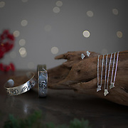 Holiday product photo shoot in my studio for Jewelry. Amy Rose In Maine silver necklaces, cuffs and earrings