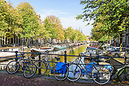 Bikes on a bridge at the canals of Amsterdam, the Netherlands.