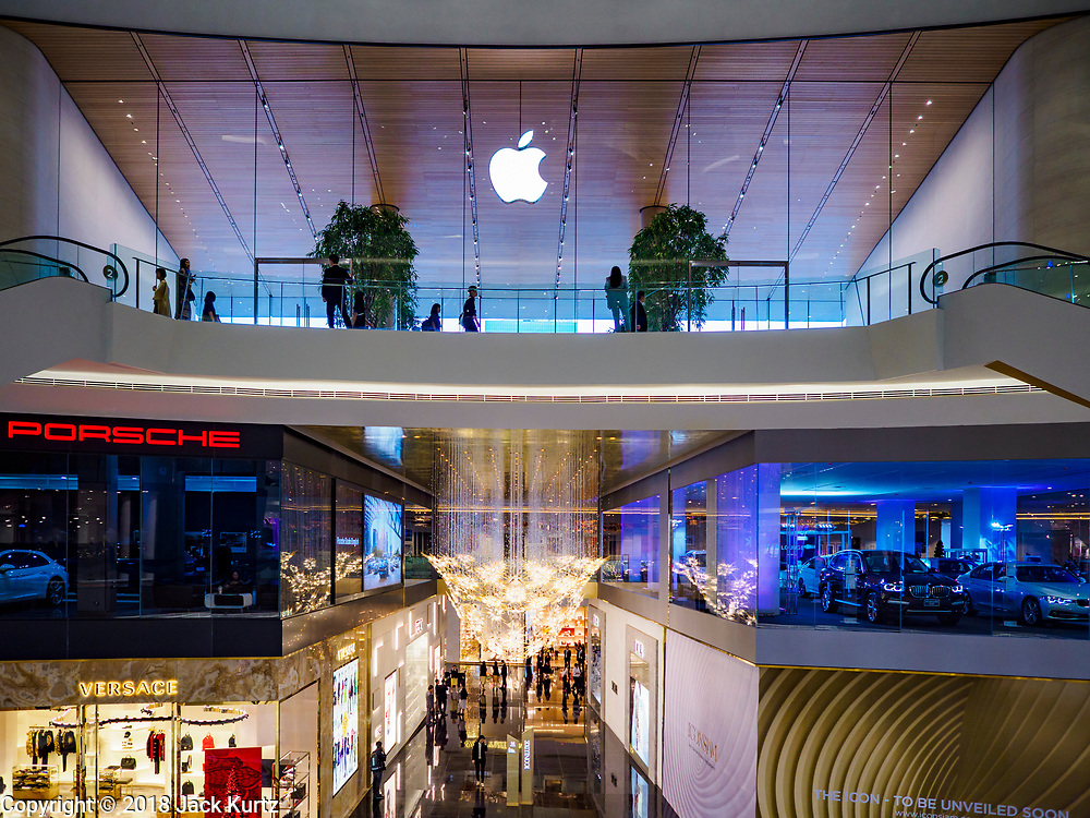 09 NOVEMBER 2018 - BANGKOK, THAILAND: The new Apple Store and car dealers in ICONSIAM during the grand opening. ICONSIAM opened November 9. The Apple Store opens Saturday, 10 November. ICONSIAM is a mixed-use development on the Thonburi side of the Chao Phraya River. It includes two large malls, with more than 520,000 square meters of retail space, an amusement park, two residential towers and a riverside park. It is the first large scale high end development on the Thonburi side of the river and will feature the first Apple Store in Thailand and the first Takashimaya department store in Thailand.     PHOTO BY JACK KURTZ