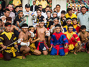 09 JANUARY 2016 - BANGKOK, THAILAND:  PRAYUTH CHAN-O-CHA, the Prime Minister of Thailand, (wearing black poses for a photo with students who performed a martial arts demonstration during Children's Day festivities at Government House. National Children's Day falls on the second Saturday of the year. Thai government agencies sponsor child friendly events and the military usually opens army bases to children, who come to play on tanks and artillery pieces. This year Thai Prime Minister General Prayuth Chan-ocha, hosted several events at Government House, the Prime Minister's office.      PHOTO BY JACK KURTZ
