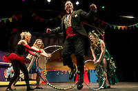 "Chris Fernandez as the Ring Master jumps through hoops on stage during dress rehearsal for Streetcar Company's production of ""Barnum"" the circus musical.  (Karen Bobotas/for the Laconia Daily Sun)"