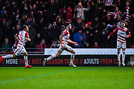 Ben Whiteman of Doncaster Rovers (8) scores a goal and celebrates with Herbie Kane of Doncaster Rovers (15) and Alfie May of Doncaster Rovers (19) to make the score 1-0 during the The FA Cup fourth round match between Doncaster Rovers and Oldham Athletic at the Keepmoat Stadium, Doncaster, England on 26 January 2019.