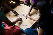 Tearfund beneficiaries play a game of Carom together in Nirmal Bhavan, a rehabilitation home for trafficked and rescued girls run by Tearfund partner NGO Oasis India, in Mumbai, Maharashtra, India on 20 February 2014. Photo by Suzanne Lee/Tearfund