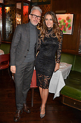 LONDON, ENGLAND 7 DECEMBER 2016: Patrick Cox, Elizabeth Hurley at an intimate performance by kylie Minogue at The Ivy, 5 West Sreet, London, England. 7 December 2016.