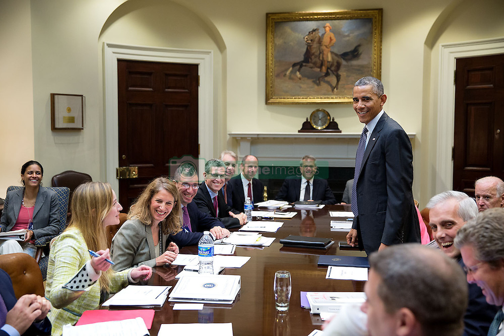 President Barack Obama shares a laugh with participants prior to an Affordable Care Act implementation meeting with Vice President Joe Biden in the Roosevelt Room of the White House, Sept. 22, 2014. (Official White House Photo by Pete Souza)<br /> <br /> This official White House photograph is being made available only for publication by news organizations and/or for personal use printing by the subject(s) of the photograph. The photograph may not be manipulated in any way and may not be used in commercial or political materials, advertisements, emails, products, promotions that in any way suggests approval or endorsement of the President, the First Family, or the White House.