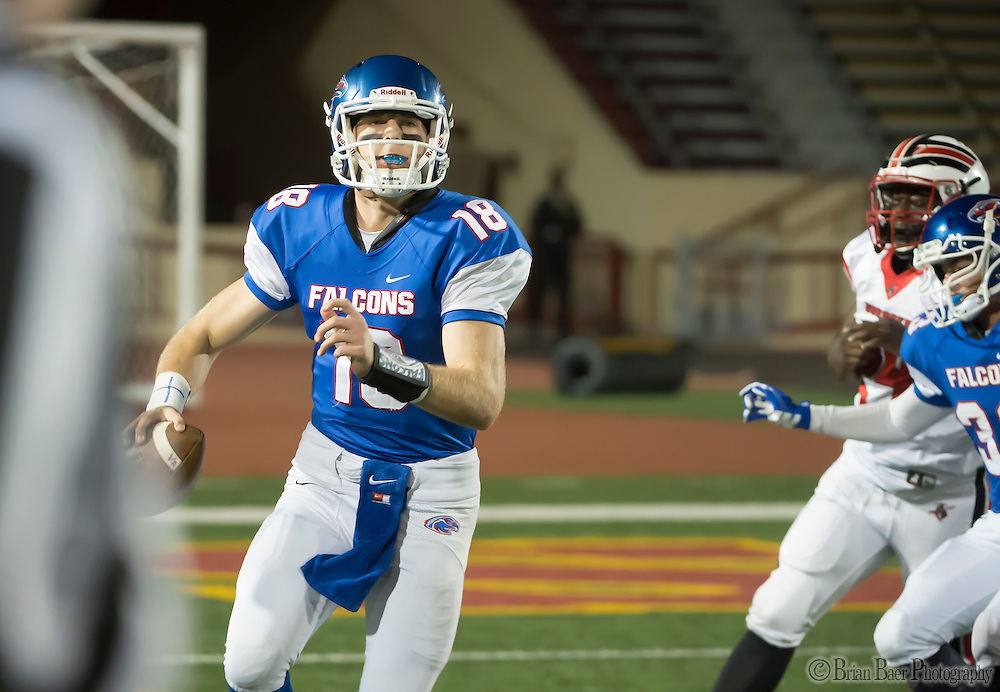 Christian Brothers Falcons Tyler Vander Waal (18), runs with the ball during the second quarter of the Sac-Joaquin Section Division I football playoff game between the Christian Brothers Falcons and Cordova Lancers at Hughes Stadium,  Friday Nov 11, 2016.<br /> photo by Brian Baer