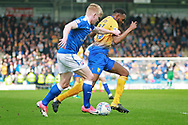 Chesterfield defender George Smith (17)  pulls back Mansfield Town defender Hayden White (16) during the EFL Sky Bet League 2 match between Chesterfield and Mansfield Town at the Proact stadium, Chesterfield, England on 14 A pril 2018. Picture by Nigel Cole.
