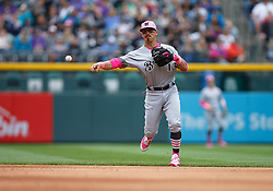 May 13, 2018 - Denver, CO, U.S. - DENVER, CO - MAY 13: Milwaukee Brewers infielder Tyler Saladino (13) fields a ground ball and throws to first base during a regular season MLB game between the Colorado Rockies and the visiting Milwaukee Brewers on May 13, 2018 at Coors Field in Denver, CO. (Photo by Russell Lansford/Icon Sportswire) (Credit Image: © Russell Lansford/Icon SMI via ZUMA Press)