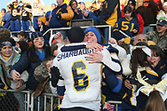 Wilmington's Carson Sharbaugh gets a hug from a Greyhound fan after Wilmington's double overtime upset victory over West Catholic in the 2008 PIAA Class AA state title game.