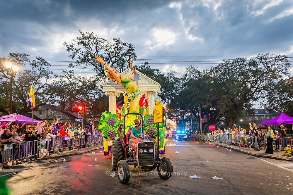The Krewe of Hermes float, Miaia, Mother of Hermes, rolls down Magazine before making the turn at Napoleon Avenue in updown New Orleans.