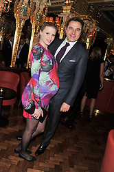 LARA STONE and DAVID WALLIAMS at the 50th birthday party for Patrick Cox held at the Café Royal Hotel, 68 Regent Street, London on 15th March 2013.