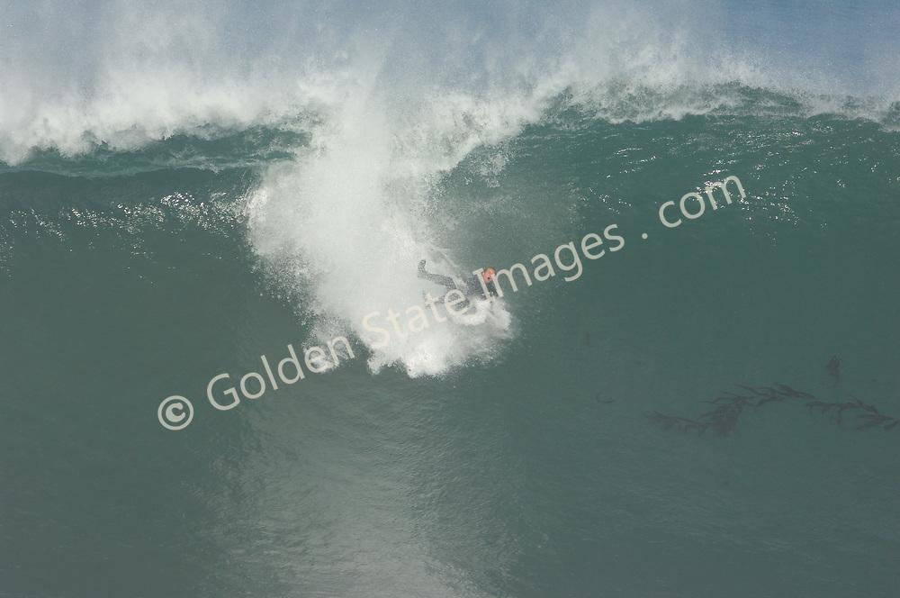 Surfer goes over the falls, 4 of 4 frames.