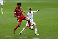 Tom Carroll of Swansea city ® challenges Philip Billing of Huddersfield Town. Premier league match, Swansea city v Huddersfield Town at the Liberty Stadium in Swansea, South Wales on Saturday 14th October 2017.<br /> pic by  Andrew Orchard, Andrew Orchard sports photography.
