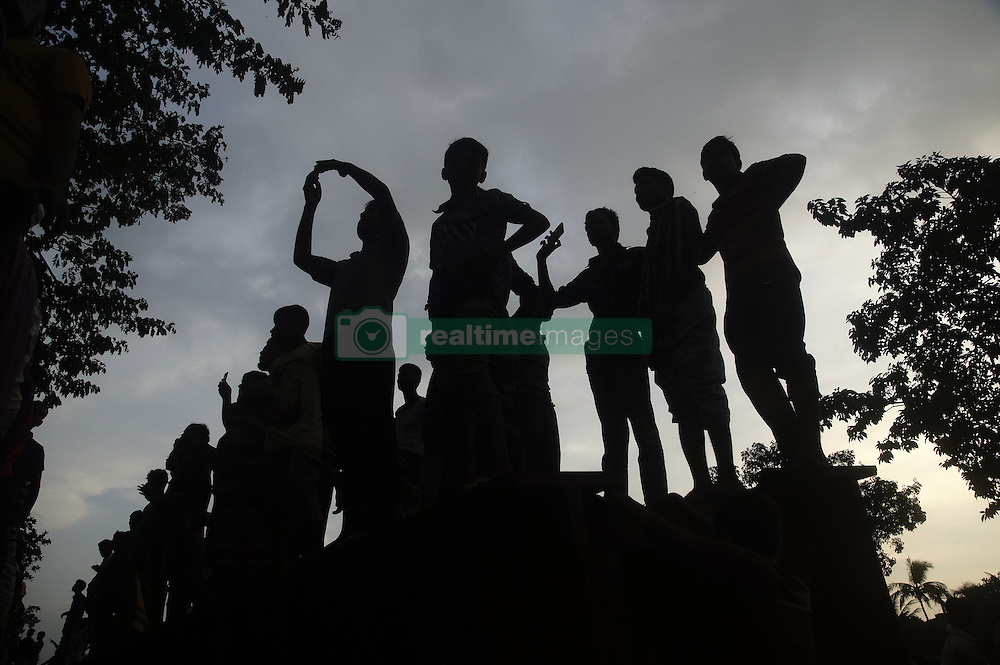 September 10, 2016 - Dhaka, Dhaka, Bangladesh - A man take photo at fire site in Tongi industrial area where a boiler exploded and triggered a fire at a packaging factory, killed 26 peoples near Dhaka. (Credit Image: © Md. Mehedi Hasan/Pacific Press via ZUMA Wire)