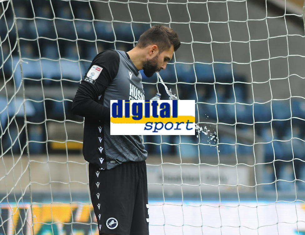 Football - 20230 / 2021 Sky Bet Championship - Wycombe Wanderers vs Millwall - Adams Park Stadium<br /> <br /> Dejected Millwall goalkeeper, Bartosz Bialkowski after trying to dribble his way out of trouble but was caught by Scott Kashket who scores his first half goal<br /> <br /> <br /> COLORSPORT/ANDREW COWIE