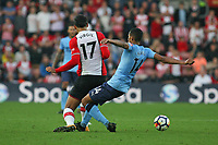 Football - 2017 / 2018 Premier League - Southampton vs. Newcastle United<br /> <br /> Isaac Hayden of Newcastle United leaves a foot in on Southampton's Virgil van Dijk at St Mary's Stadium Southampton<br /> <br /> COLORSPORT/SHAUN BOGGUST