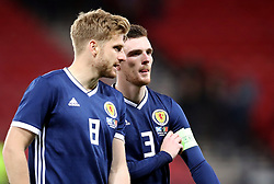 Scotland's Stuart Armstrong and Scotland's Andy Robertson leave the itch after the final whistle of the International Friendly match at Hampden Park, Glasgow.