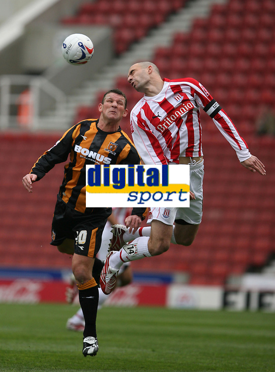Photo: Pete Lorence.<br />Stoke City v Hull City. Coca Cola Championship. 21/04/2007.<br />Dean Windass and Danny Higginbotham battle for the ball.