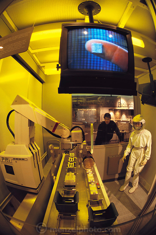"""Silicon Valley, California; Intel museum; Santa Clara, California. Clean room display A """"clean"""" room display at the Intel Museum at Intel's corporate headquarters in Silicon Valley, California. 220 Mission College Boulevard, Santa, Clara, CA 95052. Tel (408)765-0503. The museum has hands on displays to teach about computers and chip-making. Model Released (1999)."""