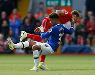 Mason Holgate of Everton in action with Lucas Leiva of Liverpool during the English Premier League match at Anfield Stadium, Liverpool. Picture date: April 1st 2017. Pic credit should read: Simon Bellis/Sportimage
