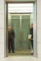 06 MAR 2001, BERLIN/GERMANY:<br /> Gerhard Schroeder, SPD, Bundeskanzler, nach dem Besuch der SPD Fraktionssitzung im Fahrstuhl, Deutscher Bundestag, Reichstagsgebaeude<br /> IMAGE: 20010306-03/01-24<br /> KEYWORDS: Gerhard Schröder