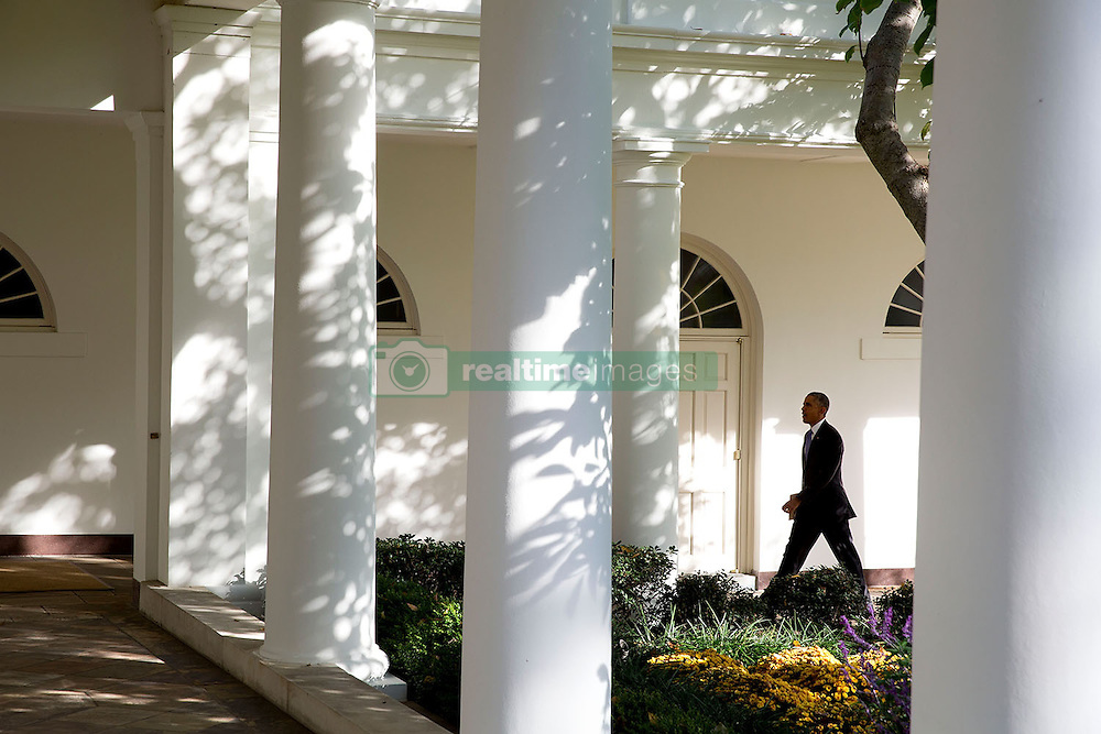 President Barack Obama walks on the Colonnade of the White House, Oct. 29, 2014. (Official White House Photo by Pete Souza)<br /> <br /> This official White House photograph is being made available only for publication by news organizations and/or for personal use printing by the subject(s) of the photograph. The photograph may not be manipulated in any way and may not be used in commercial or political materials, advertisements, emails, products, promotions that in any way suggests approval or endorsement of the President, the First Family, or the White House.