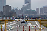 A passenger aircraft is landing in London City Airport on Monday, July 27, 2020. After the British Government said that anybody travelling to Spain from Britain will now need to self-isolate for 14 days when they return, airlines connecting Britain to Spain have issued guidance to anybody with flights booked to Spain - and says that it will be continuing to operate, despite the new restrictions. (VXP Photo/ Vudi Xhymshiti)