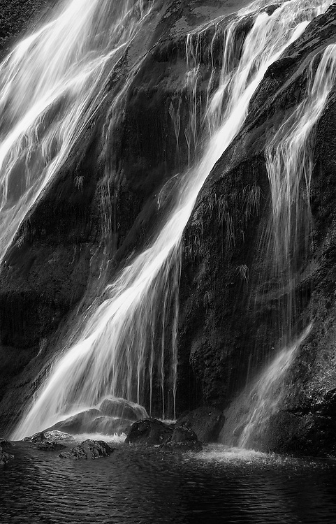 Waterfall at Powerscourt, Co.Wicklow, Ireland. After heavy rainfall, this is always a good bet for an interesting photo. With the sun at the right angle, bouncing off the falling water, a dramatic image is possible, here, a long shutter speed was used to get this popular water effect.