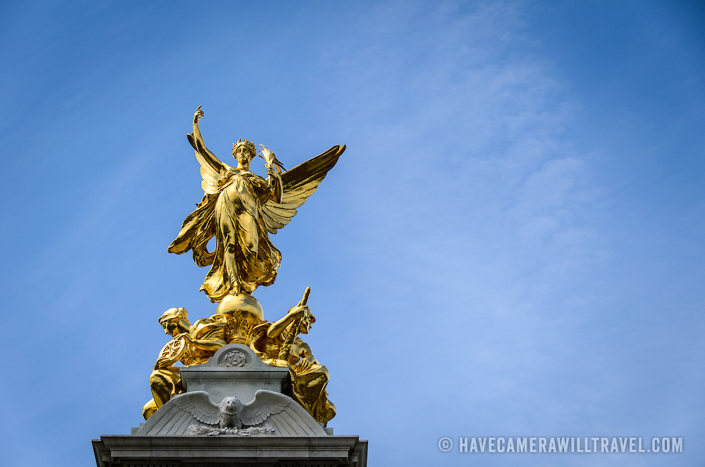 Victoria Memorial Statue at Buckingham Palace London with Copyspace 169-110729700 The Victoria Memorial, dedicated to Queen Victoria, sits directly in front of Buckingham Palace, with Queen Victoria facing The Mall. Includes copyspace.