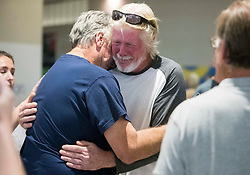 September 13, 2017 - Tampa, Florida, U.S. - Shrimp boat captain EDWARD POTTER is reunited with fellow shrimp boat captain RICK SHALANSKY, and his wife and family at Tampa International Airport, after being rescued by a Carnival Cruise ship during Hurricane Irma. Potter was on his shrimp boat about 40 miles from Fort Jefferson during the hurricane. Carl Sheperd, Potter's deckhand, boat, and boat cat named Motorboat, didn't make it. (Credit Image: © Monica Herndon/Tampa Bay Times via ZUMA Wire)