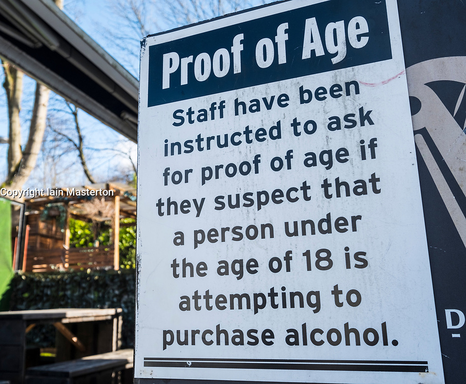 Sign outside pub warning of age restrictions