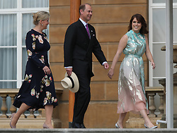 The Countess of Wessex, the Earl of Wessex and Princess Eugenie of York attending the Duke of Edinburgh Gold Award presentations in the Buckingham Palace garden, London.