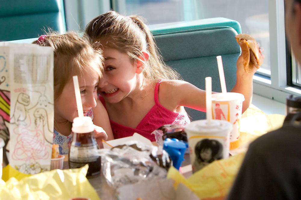 WATERBURY, CT- 25 SEPT 2007- 092507JT02- .Tinker School kindergarteners Lena Neri, 5, and Christina Capozzi, 5, eat dinner at McDonald's on Tuesday in Waterbury during a three-hour fundraiser for the school in which 10% of the profits made at the store or a $300 minimum goes to the school..Josalee Thrift / Republican-American