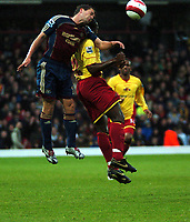Photo: Tony Oudot.<br /> Watford v Newcastle United. The Barclays Premiership. 13/05/2007.<br /> Michael Owen of Newcastle challenges Lloyd Doyley of Watford to a header