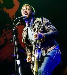 © Licensed to London News Pictures. 12/12/2012. London, UK.   Dan Auerbach of The Black Keys performing live at The O2 Arena. The Black Keys is an American rock band formed in Akron, Ohio in 2001. The group consists of Dan Auerbach (guitar, vocals) and Patrick Carney (drums).   Photo credit : Richard Isaac/LNP