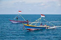 Local boats, decorated to celebrate the festival of the spring tides. Biak, Indonesia