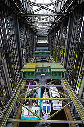 View of boats being raised inside historic ship lift at Niederfinow in Brandenburg, Germany
