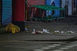 © Licensed to London News Pictures. 11/11/2020. Slough, UK. Evidence identification markers sit next to blood soaked medical waste on Stoke Poges Lane. A person was reportedly stabbed in Slough on Tuesday 10/11/2020. A large cordon was put in place by Thames Valley Police centred around shops on Stoke Poges Lane and included a large section of Bradley Road. Photo credit: Peter Manning/LNP
