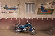 A parked motorcycle under Islamic and travel murals in a street of the village of Bairat on the West Bank of Luxor, Nile Valley, Egypt. Islam in Egypt is the dominant religion in a country with around 80 million Muslims, comprising 94.7% of the population, as of 2010. Almost the entirety of Egypt's Muslims are Sunnis, with a small minority of Shia and Ahmadi Muslims. The latter, however, are not recognised by Egypt.