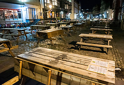"© Licensed to London News Pictures; 25/09/2020; Bristol, UK. King Street which is normally busy after 10pm in the city centre is deserted for a Friday night, on the first weekend of the 10pm early closing curfew for pubs, bars and restaurants across the UK, imposed by the government to try and halt a second wave of the covid-19 coronavirus pandemic. Gathering in groups of more than six people is also banned and there are penalties of £200 on the first offence. From Monday 14 September it was illegal to meet up socially in groups of more than six people, known as the ""Rule of Six"", in order to try and contain the spread of the covid-19 coronavirus pandemic. Photo credit: Simon Chapman/LNP."