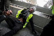 A protester hit by a flash bomb on his stomach. More than 125000 gathered in Paris for the Gilets Jaune (Yellow vest) protest. Soon the protest turned violent an protesters clashed with the police, tear gas and flash bombs were fired, many injured and arrested by the police. Paris December 6th 2018. Federico Scoppa