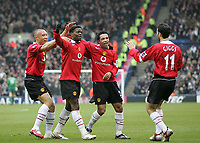 Photo: Lee Earle.<br /> West Bromwich Albion v Manchester United. The Barclays Premiership. 18/03/2006. United's Luis Saha (2ndL) is congratulated after scoring the opening goal.