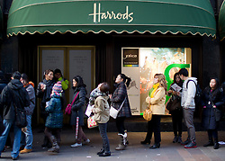 © Licensed to London News Pictures. 26/12/2012. London, UK. Shoppers queue to take advantage of the deals on offer at Harrod's Boxing Day Sale in London today (26/12/12). Photo credit: Matt Cetti-Roberts/LNP