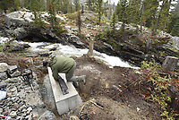 Grand Teton National Park trail crewman Brock Foster works on the support structure for what will be a new bridge across Cascade Creek last week just west of Jenny Lake in Grand Teton National Park. The work is part of the Jenny Lake Renewal Parject, a five-year restoration and upgrade effort of trails and services around the lake.
