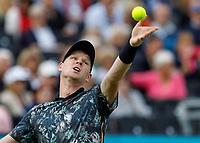 Tennis - 2019 Queen's Club Fever-Tree Championships - Day Three, Wednesday<br /> <br /> Men's Singles, First Round: Stefanos Tsitsipas (GRC) Vs. Kyle Edmund (GBR)<br /> <br /> Kyle Edmund (GBR) serves on Centre Court.<br />  <br /> COLORSPORT/DANIEL BEARHAM