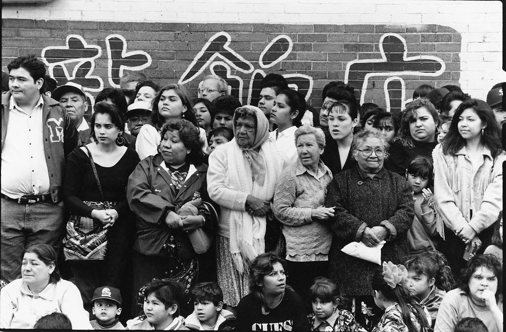 ©1993 Hispanic crowds watching the Geroge Washington's Birthday parade in downtown Laredo, Texas in February.